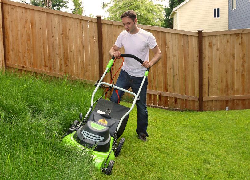 Man cutting the grass Guy pushing lawn mower